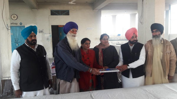 Dr. Naginder Kaur, Principal and Village Panchayat, honouring Dr. Manmeet Manav, Agriculture Development Officers
