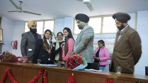 Rtr. Nitika Pahwa, DRR- RD-3070 Fixing Designation Pin to Secretary Saloni Kapoor of Rotaract Club