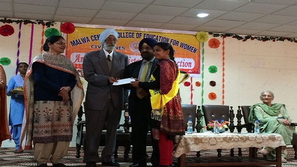 S. Raman Singh Sidhu, Chairman European Business Group Federation and S. Pritpal Singh Grewal, President, Management Committee of Malwa Central College of Education with Dr. Naginder Kaur Distributing Prizes